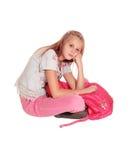 Muchacha de mirada triste con la mochila rosada Imágenes de archivo libres de regalías