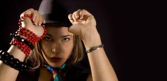 Muchacha de moda con el sombrero Foto de archivo libre de regalías