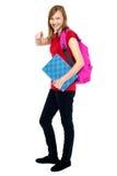 Muchacha de moda de la High School secundaria que señala en usted Imagenes de archivo