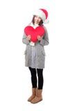 Muchacha de Navidad que sostiene la almohada de la dimensión de una variable del amor Foto de archivo libre de regalías