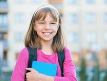 Muchacha de nuevo a escuela Fotografía de archivo