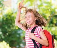 Muchacha de nuevo a escuela Foto de archivo libre de regalías
