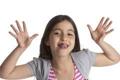Muchacha de ocho años que hace caras Fotografía de archivo libre de regalías
