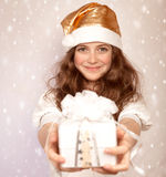 Muchacha de Papá Noel con el presente Imagenes de archivo