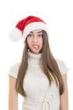 Muchacha de Papá Noel que hace la expresión facial divertida Fotografía de archivo libre de regalías