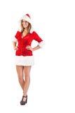 Muchacha de Papá Noel que se coloca con las manos en caderas Fotos de archivo libres de regalías