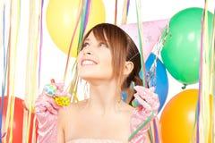 Muchacha de partido con los globos Foto de archivo libre de regalías