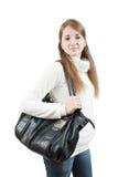 Muchacha de pelo largo con el bolso sobre blanco Imagen de archivo