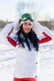 Muchacha de pelo largo en traje de esquí Imagen de archivo libre de regalías