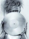 Muchacha de plata con el vinilo imagen de archivo