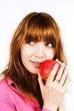 Muchacha de Redhair con la manzana Imagen de archivo