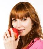 Muchacha de Redhair con la manzana Fotos de archivo