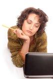 Muchacha de risa con el ordenador portátil Fotografía de archivo