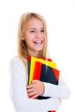 Muchacha de risa con los cuadernos Fotos de archivo