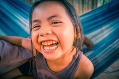 Muchacha de risa en hamaca en Bolivia Imagenes de archivo