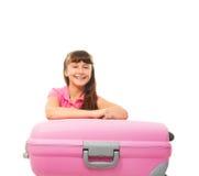 Muchacha de risa feliz con la maleta Imagen de archivo libre de regalías