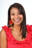 Muchacha de risa feliz hermosa del Latino en rojo Fotos de archivo libres de regalías