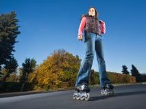 Muchacha de Rollerblading Imagen de archivo libre de regalías