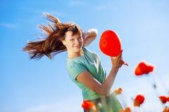 Muchacha de salto con el globo Imagenes de archivo