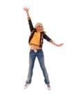 Muchacha de salto del Blonde de los pantalones vaqueros. Fotos de archivo libres de regalías