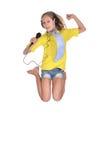 Muchacha de salto en la camisa amarilla Fotografía de archivo libre de regalías