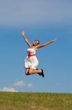 Muchacha de salto sonriente Imagen de archivo