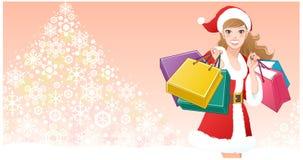 Muchacha de Santa con los bolsos de compras en árbol del copo de nieve Imagenes de archivo