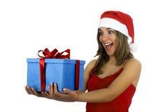 Muchacha de Santa con los regalos Foto de archivo