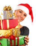 Muchacha de Santa con los regalos Imagen de archivo