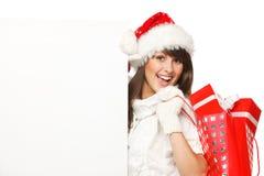 Muchacha de Santa con los regalos y la bandera Foto de archivo libre de regalías