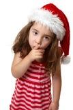 Muchacha de Santa hushing o que gesticula para la tranquilidad imagenes de archivo