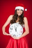Muchacha de Santa que señala en el tiempo - Año Nuevo ya Imágenes de archivo libres de regalías