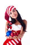 Muchacha de Santa que sostiene una bola de la Navidad Fotografía de archivo