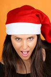 Muchacha de tomadura de pelo de Papá Noel Imagen de archivo
