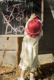 Muchacha de un año en un sombrero rojo fotografía de archivo libre de regalías