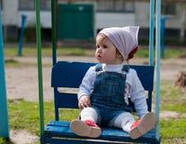 muchacha de un año en un oscilación Fotos de archivo libres de regalías
