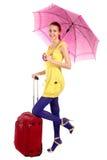 Muchacha de Yung con la maleta roja Fotos de archivo