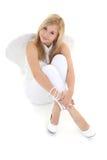 Muchacha del ángel que se sienta en blanco Imagen de archivo libre de regalías