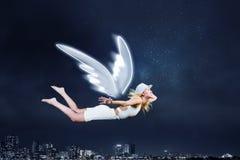 Muchacha del ángel que vuela arriba Fotografía de archivo libre de regalías