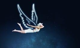 Muchacha del ángel que vuela arriba Fotos de archivo libres de regalías
