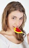 Muchacha del adolescente con el lollipop Foto de archivo