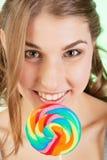 Muchacha del adolescente con el lollipop Imagenes de archivo