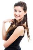 Muchacha del adolescente con el pelo largo en blanco aislado Imagen de archivo