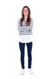 Muchacha del adolescente con la camiseta rayada y sus los brazos cruzados Fotografía de archivo