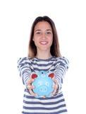 Muchacha del adolescente con la hucha azul Fotos de archivo
