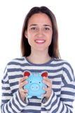 Muchacha del adolescente con la hucha azul Imagenes de archivo