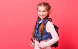 Muchacha del adolescente con la mochila de cuero negra Foto de archivo libre de regalías