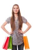 Muchacha del adolescente con los bolsos de compras Fotografía de archivo