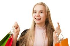 Muchacha del adolescente con los bolsos de compras Imagenes de archivo