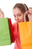 Muchacha del adolescente con los bolsos de compras Fotos de archivo